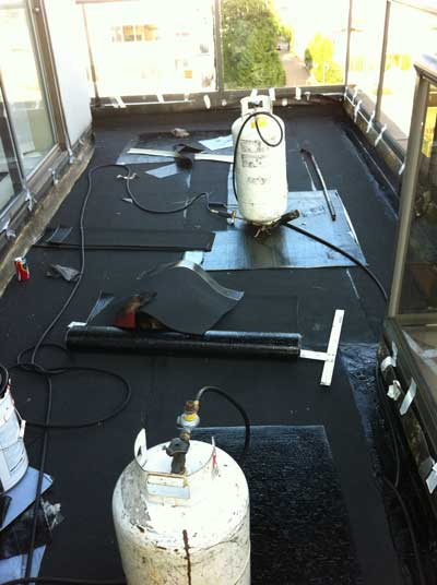 400x533_WestcoastRoofing_Services_FlatRoofs_ModifiedBitumen_torch-on